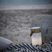 aGlow gold på stranden